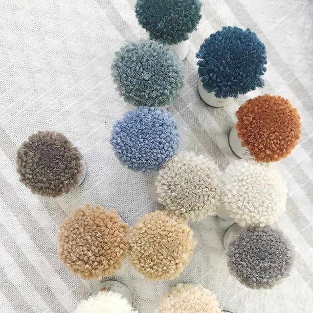 Choosing color poms for carpet- while right now it doesn't look like much just wait until you see the final product. #interiordesign #designer #colorpoms #carpet #hotel #sanantonio