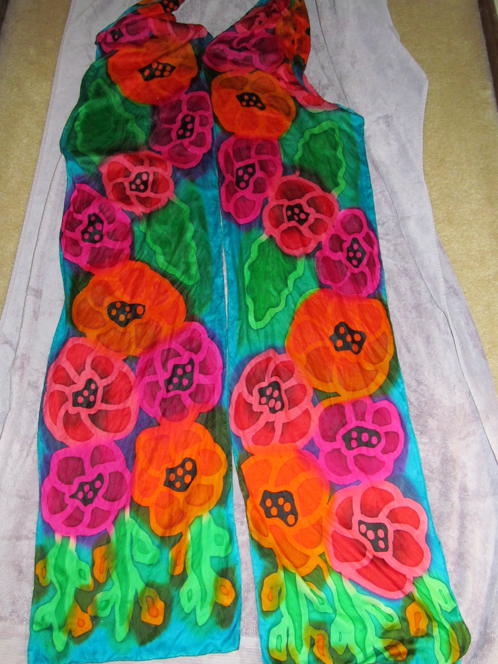 Hand painted silk scarves ready to roll up!