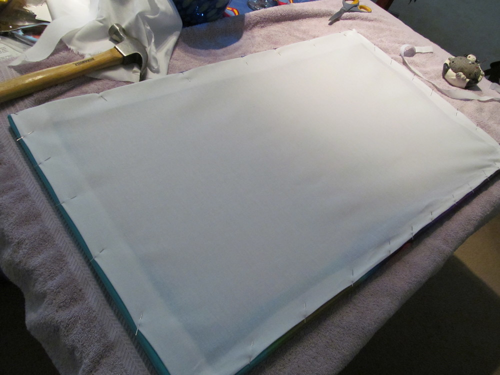 A muslin backing is sewn on to protect the silk.