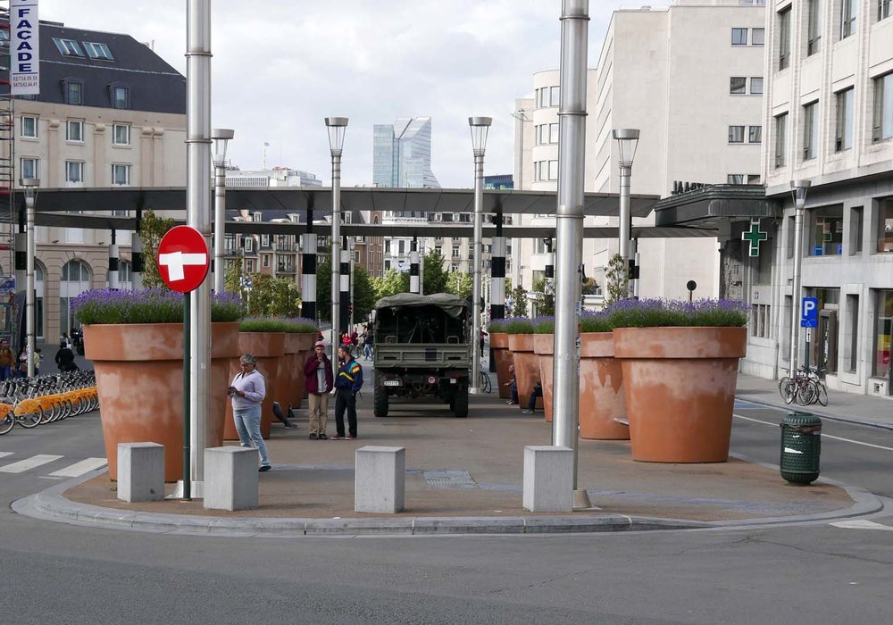 giant flower pots with army truck