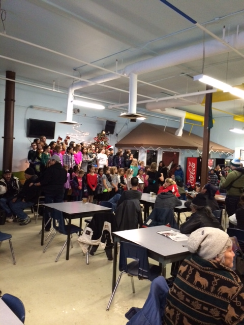 George H. Luck students singing to the guests at the Boyle Street Centre.