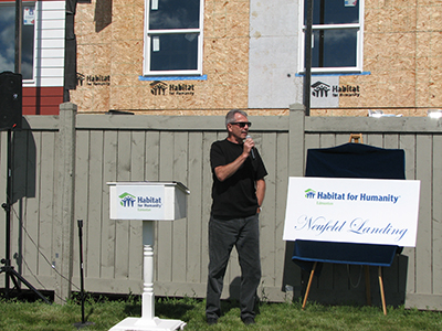 Bryan speaking on behalf of the City at the Neufeld Landing Habitat for Humanity Opening.