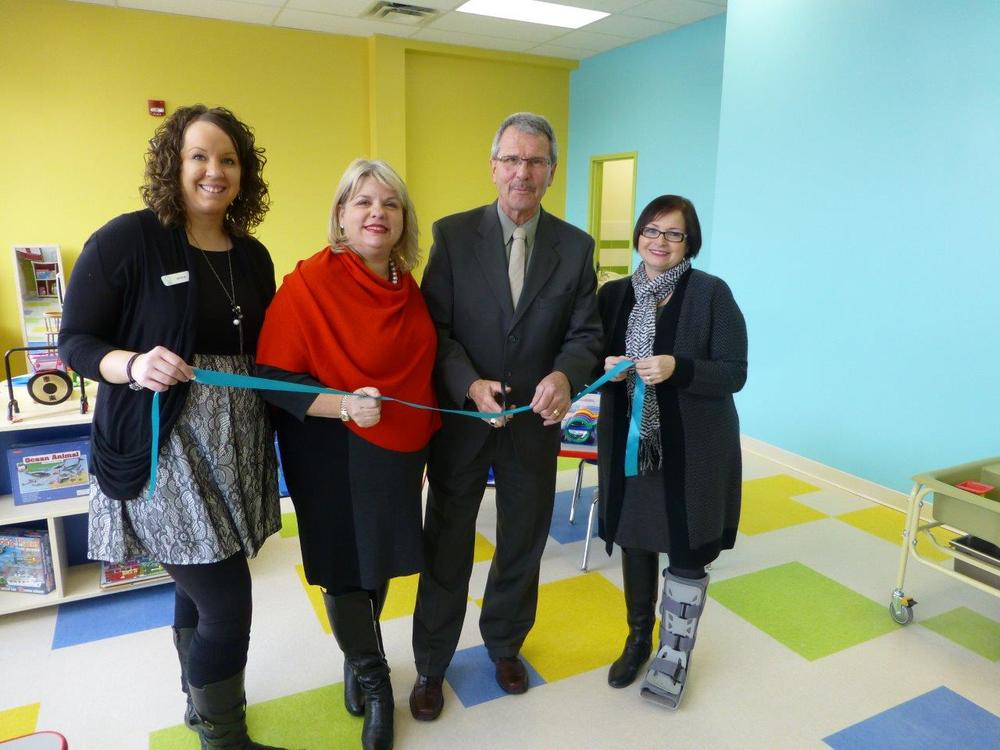 Grand opening event at Kids and Company new Ellerslie location. Area Director Nicole Tolsma, CEO Victoria Sopik, VP Operations Sue Purser, with Councillor Anderson. ( Feb 4, 2014)