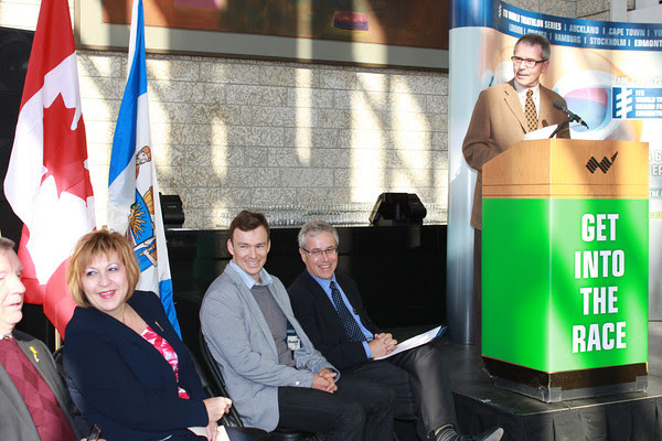Councillor Anderson speaking at the ITU media announcement Feb 28, 2014.  Seated L to R are Laurie Hawn, Heather Klimchuk, Simon Whitfield, and Don Lowry.