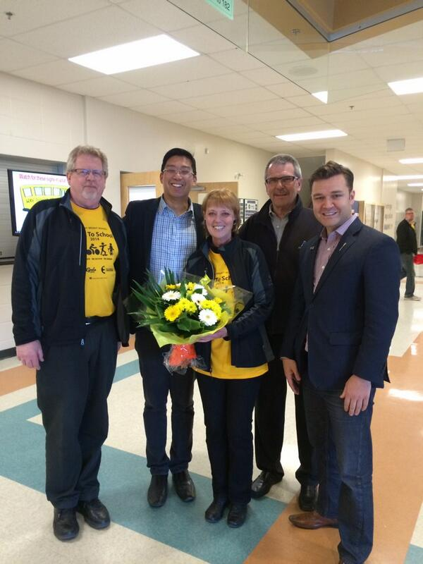 Councillor Anderson with school Principal Scott Millar, Trustee Nathan Ip, parent volunteer for the Walk to School program, Jennifer Harbin, and MLA Matt Jeneroux.