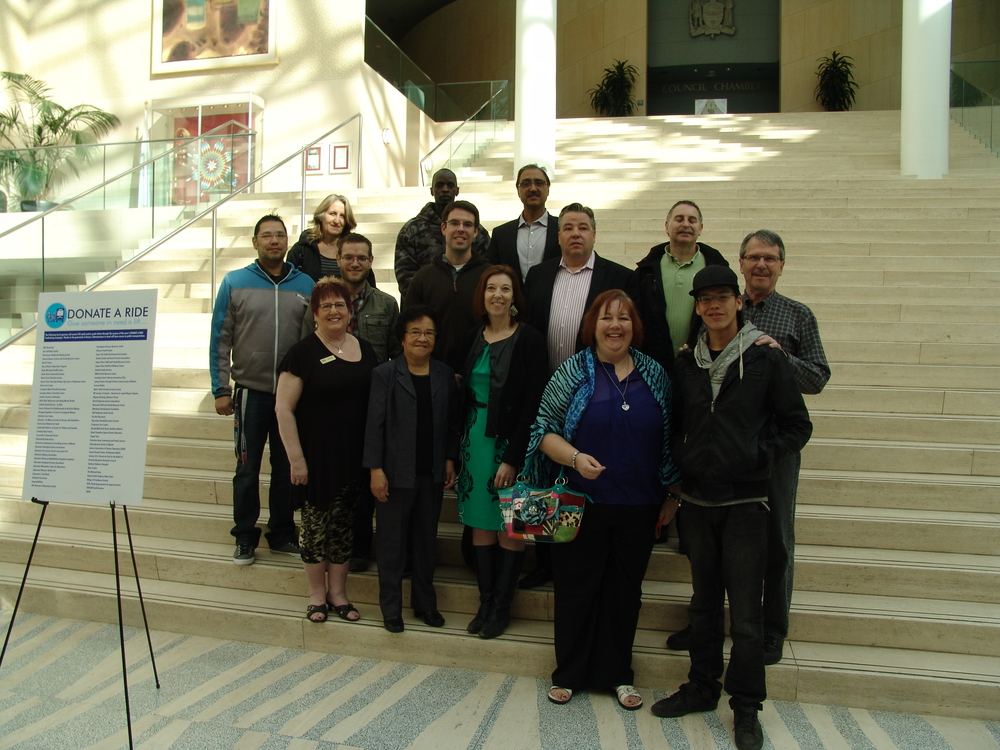 At the DONATE A RIDE wrap up event on April 17, 2015.  Councillors Anderson and Loken with a group of Agencies who will receive transit tickets this year.