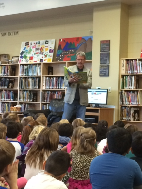 Councillor Bryan Anderson reads to the grade 1-3 children at Esther Starkman School during Read In Week 2015.