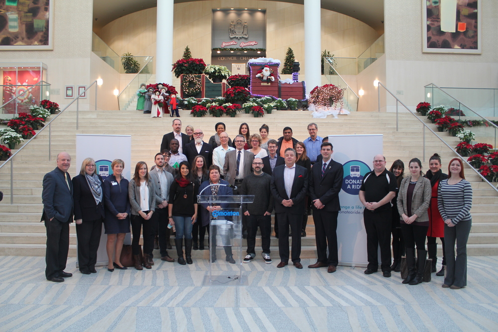 Sponsors and agencies along with Council members gather for a group photo at the kick off event at City Hall.