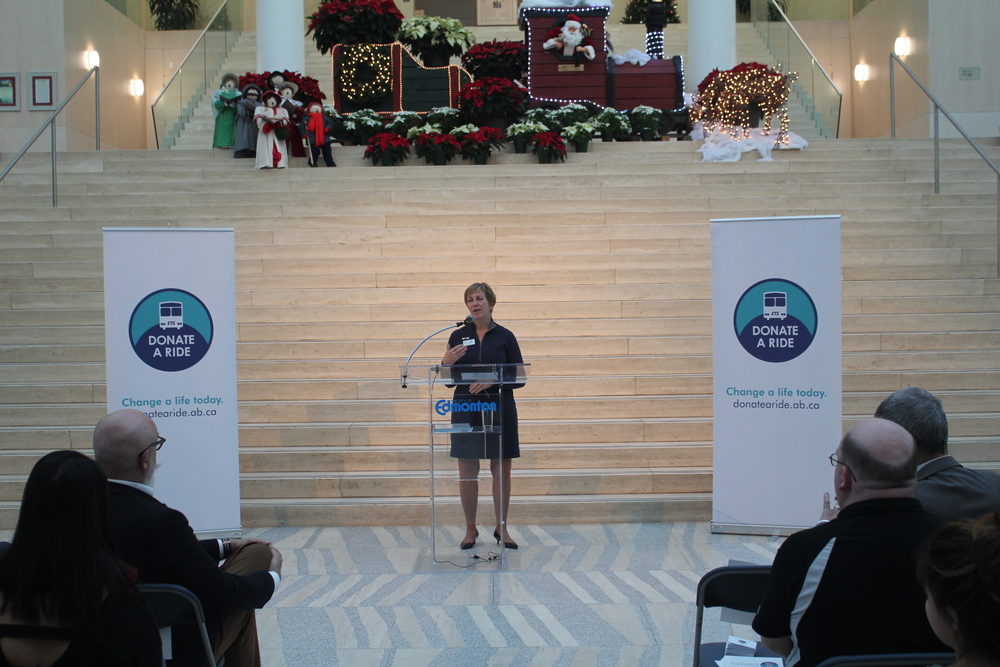 Karen Good, from Y.E.S.S. speaks at the kick off and reminds us of the value of transit tickets to youth in the City.