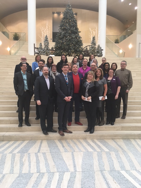Dec 19, 2016. The group of agency representatives, corporate sponsors, City Councillors and Mayor gather for a photo.
