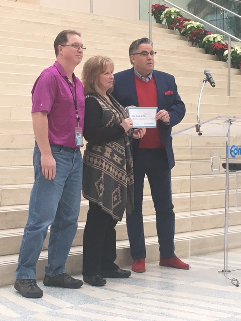 Councillor Loken accepts a cheque from ETS Fleet service staff who have been contributing to the campaign for 5 years.