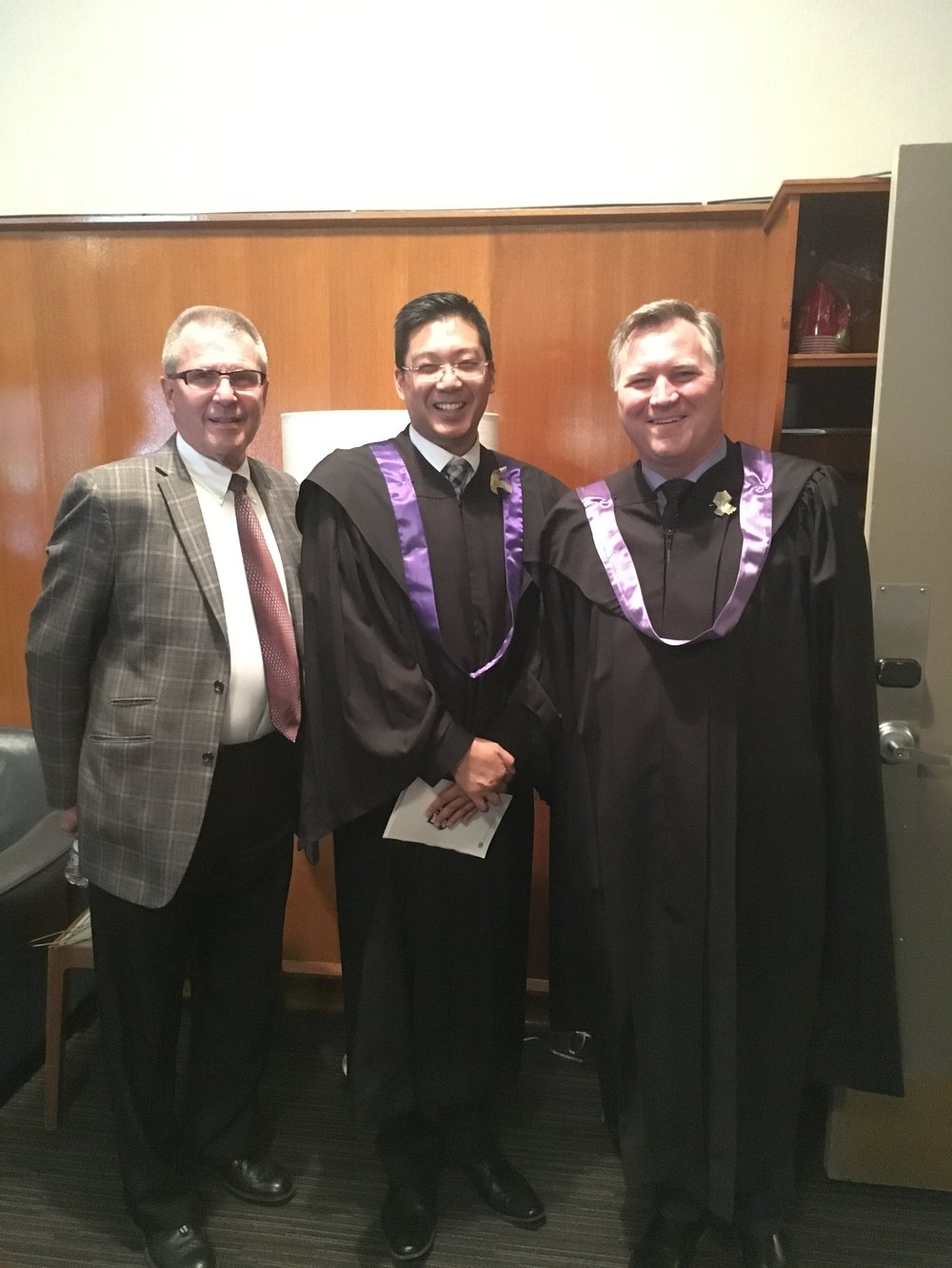 Councillor Anderson with Trustee Nathan Ip and Minister Richard Feehan.