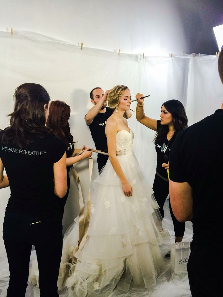 The WarPaint Artistic team, Jessica Mae, Mariah, Benjamin, & Carla putting finishing touches on bridal model Alexis. Gown courtesy of Posh Bridal.
