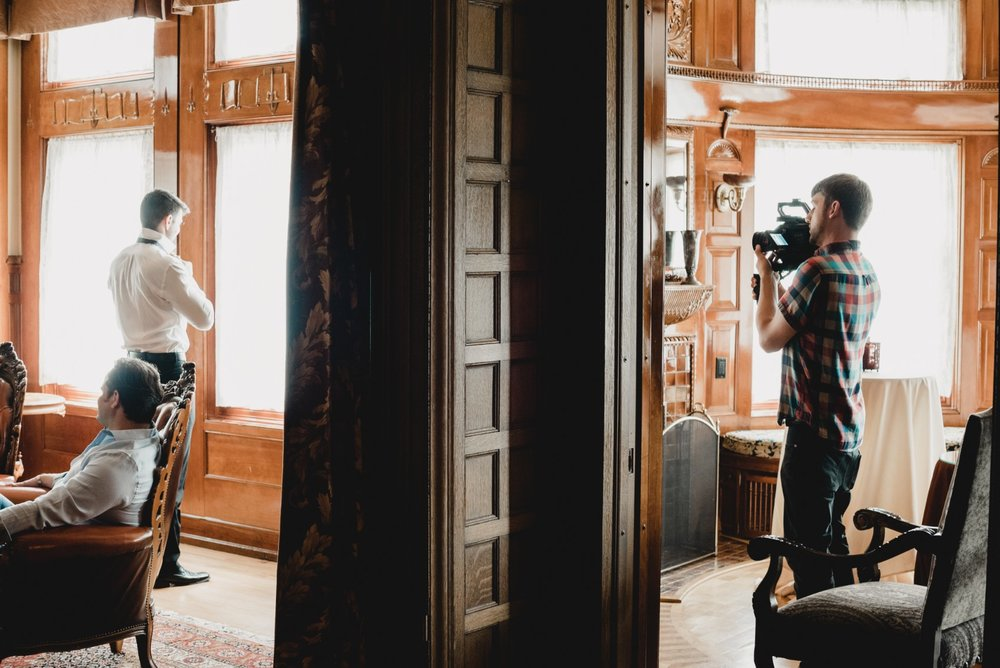 A BTS view of Gerick Engle shooting the groom.
