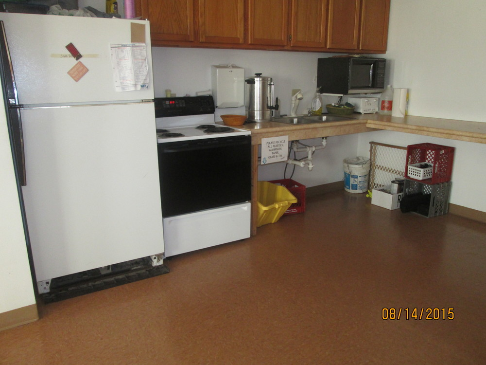 Kitchenette has fridge, microwave, and oven.