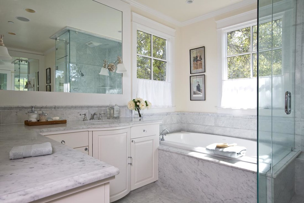 Bright and airy Carrera Marble Master Bath