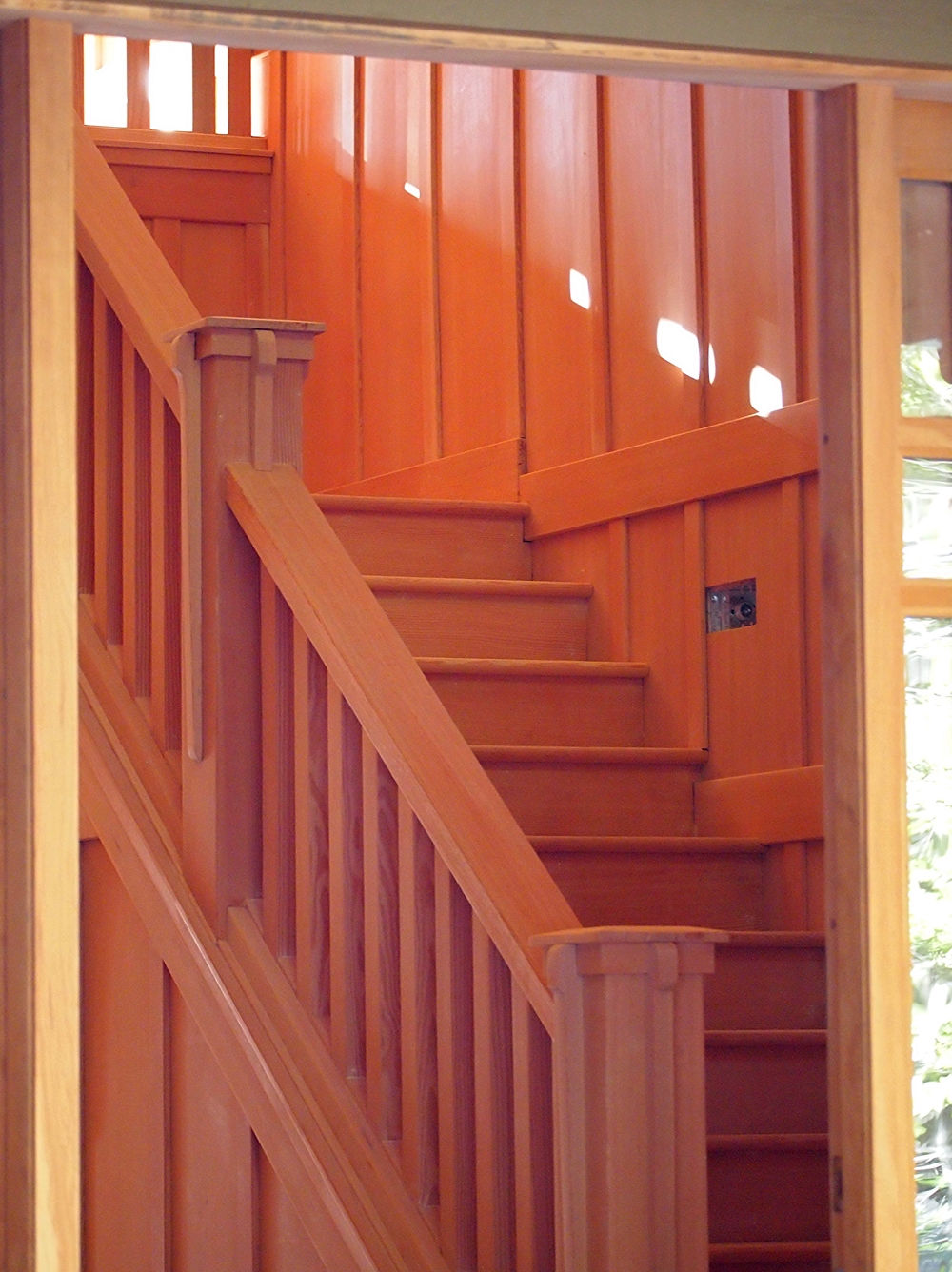 Vertical grain fir staircase in Arts & Crafts vineyard home