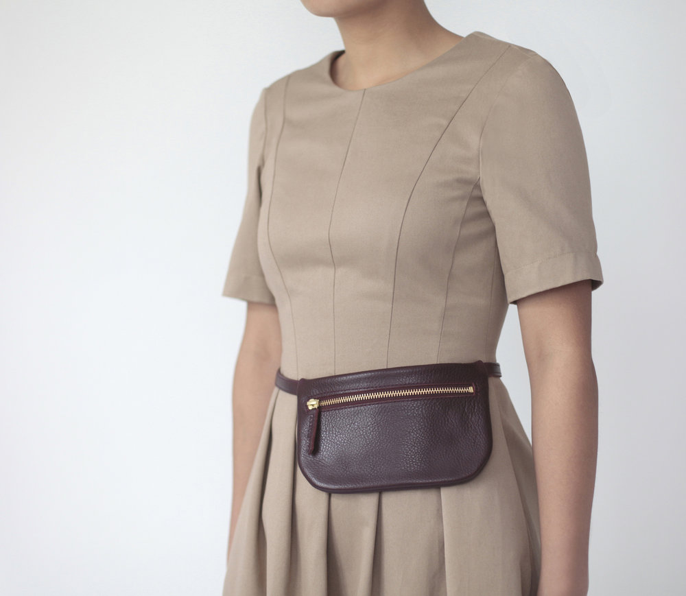 https://www.etsy.com/listing/513063919/buckle-clutch-pale-tan-braided-suede?ref=shop_home_feat_1