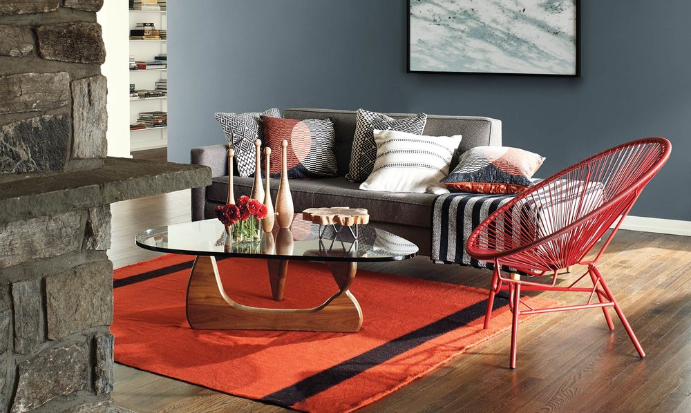 RED ENLIVENS, bringing depth and energy to a space and spiking deep grays with life.