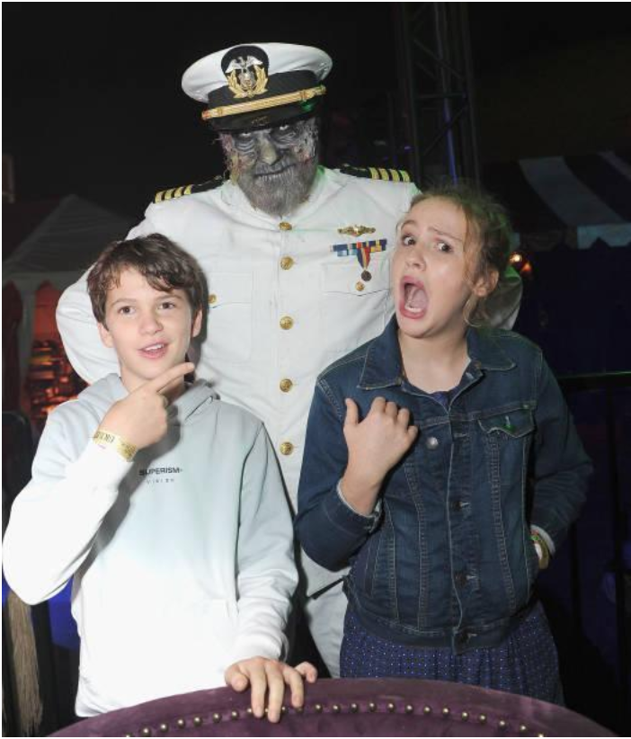 Star of hit film    Lights Out    Gabriel Bateman poses with sister and star of    Annabelle,    Talitha Bateman    with Dark Harbor's Iconic Captain on Friday, September 28, 2018