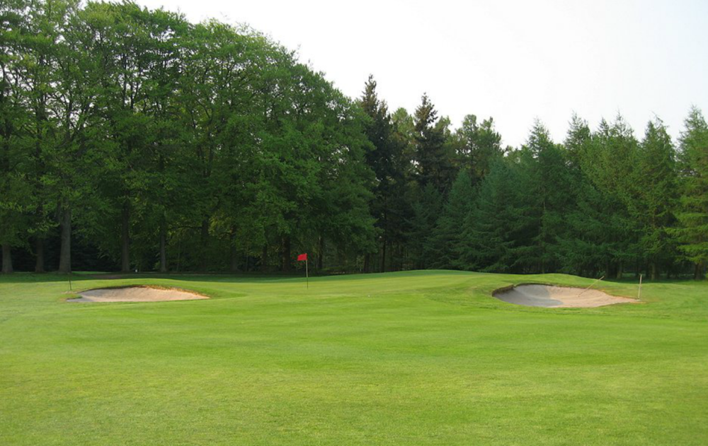 Hole 13 green before.  This image is also taken before the front right bunker was changed in-house in recent years.