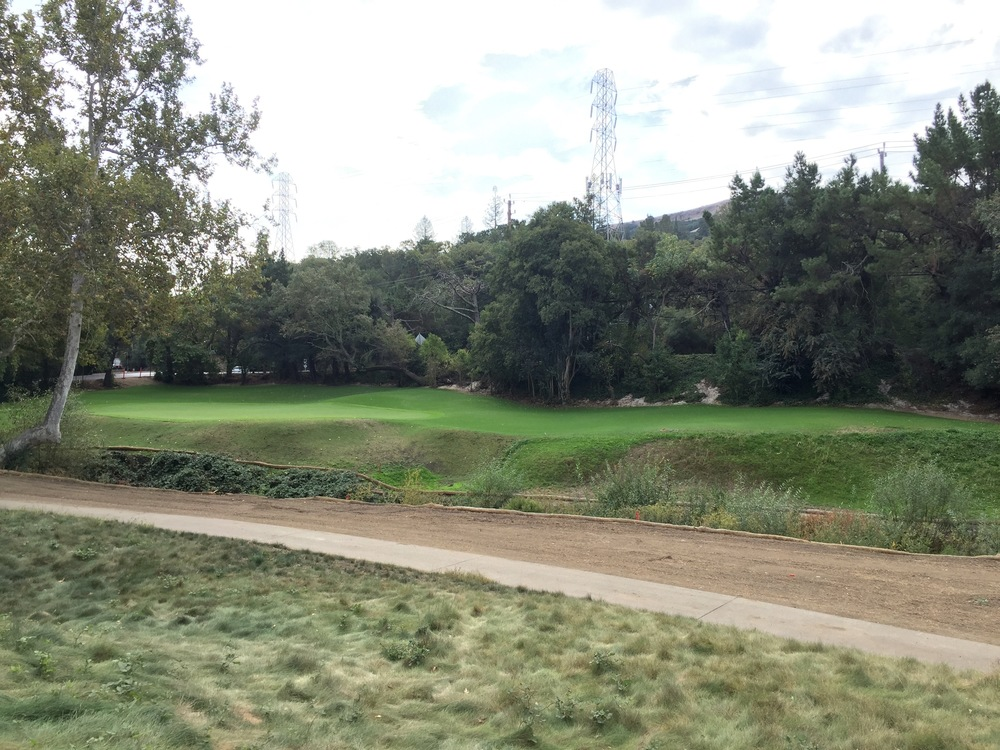 The 15th hole during grow-in, as seen from the 12th hole tees.