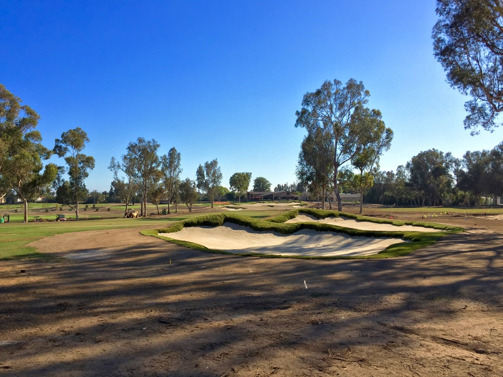 A pair of profiled bunkers on the new finishing hole at Santa Ana; the green is up in the distance.
