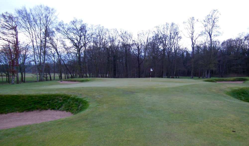 The greens at Chantilly are understated brilliance.  They adhere to the broad movements of the site, and they are full of simple and subtle moves that make a big impact upon play.  Look here at the two balls.  The one on the right was rolled right at the flag.  The one on the far left edge was rolled about 10 feet (3 meters) left of the flag.