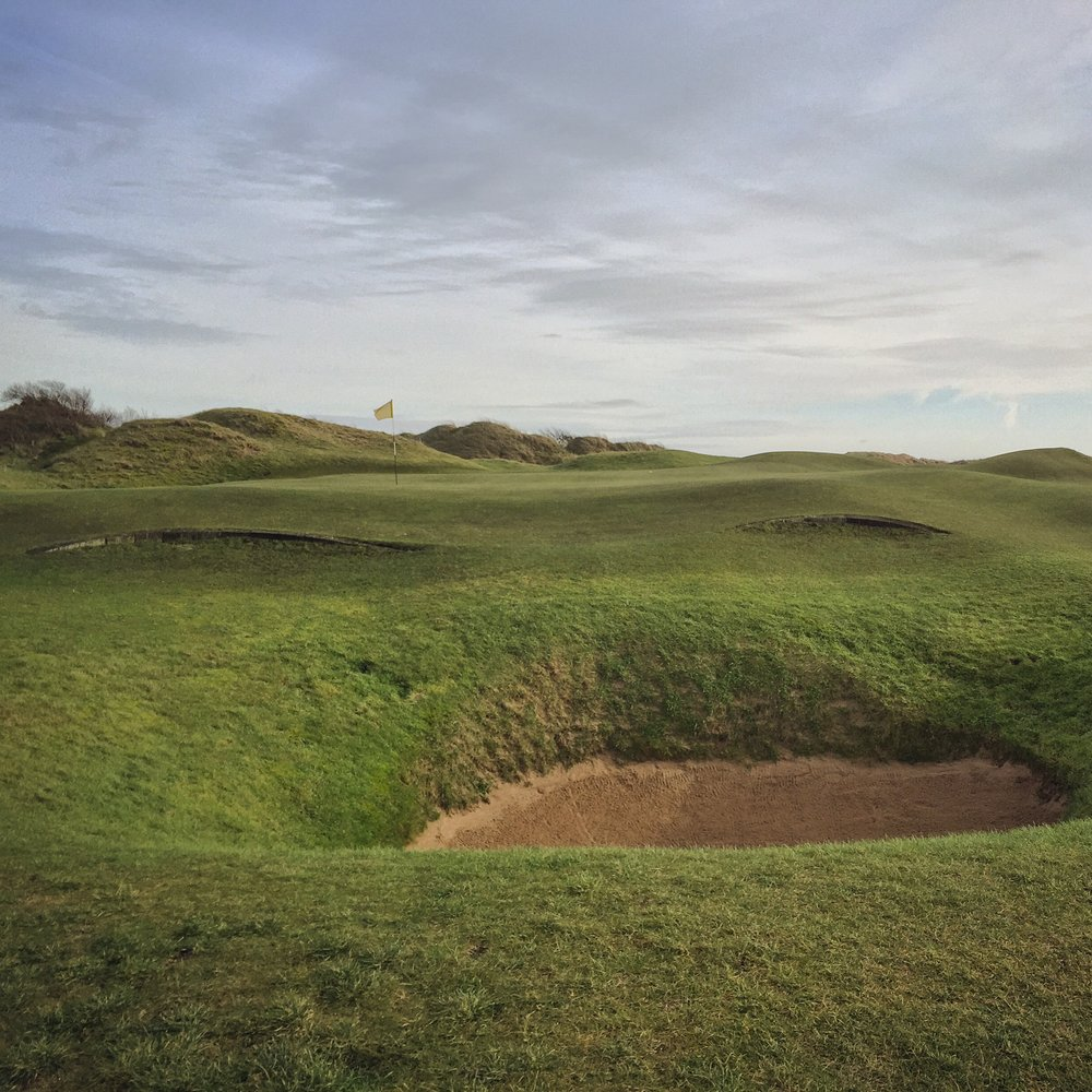 "Small wooden ledges, nicknamed ""Rye-brows,"" found on some of the holes at Rye force a pitch shot over them.  A unique and effective feature, it is well-timed throughout the round and not overdone, which it well could be."