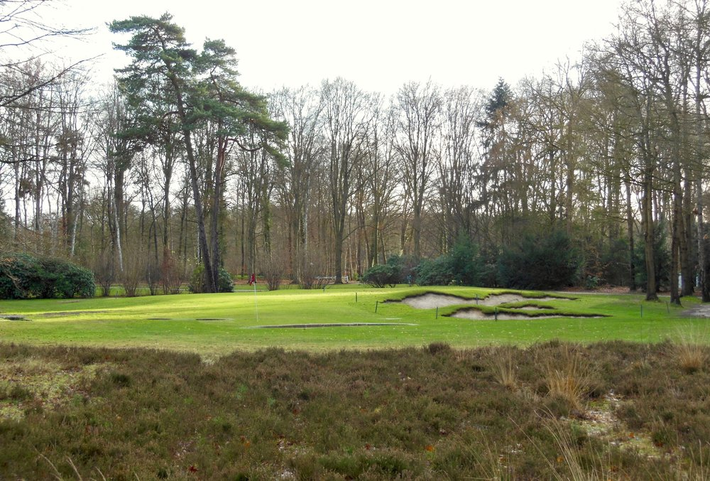 The 9th hole from the ground.  Note the flag you see is a winter hole in the approach area; the green is behind and left of the bunkers.