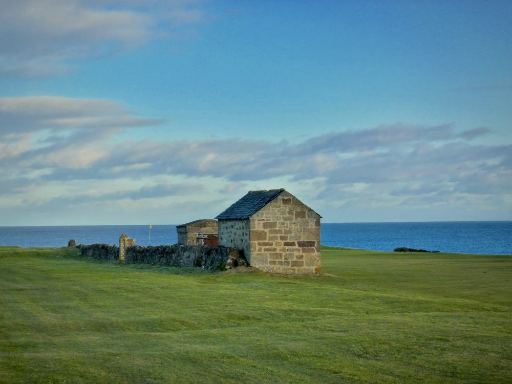 Not a bunker, but this old wall and stone shed at Anstruther make for a perfect hazard to defend the green from those who play safely away from the cliffs