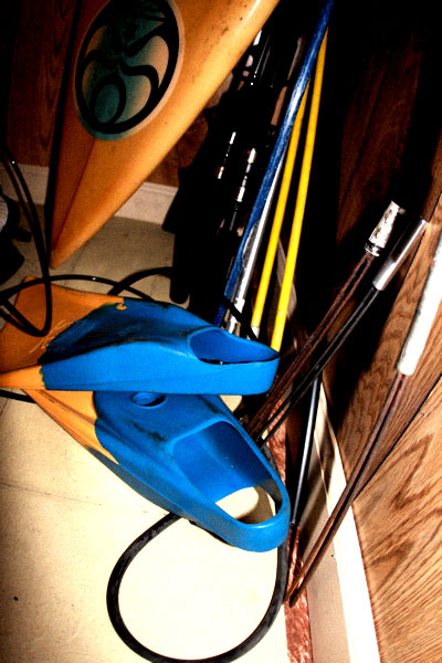 Fishing poles, three prongs, fins and surfboards