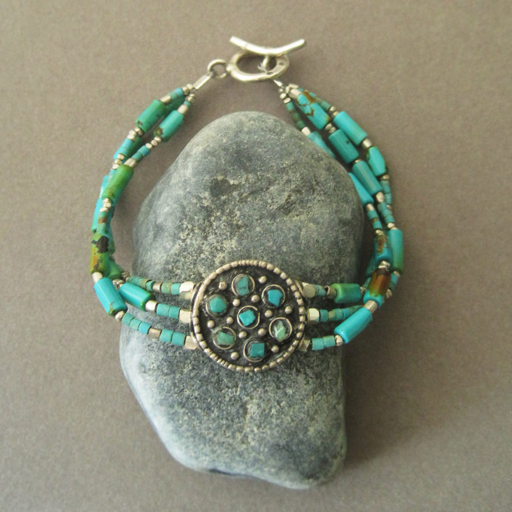 Tibetan center bead (silver & turquoise), three strands of natural turquoise, Bali silver beads, Hill Tribe handmade clasp