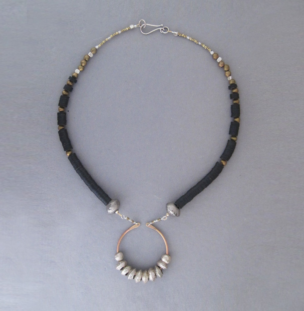 Silver Sun Necklace - Ethiopian nickel silver beads, black vulcanite heishe, brass beads, brass wire, vintage silver beads.
