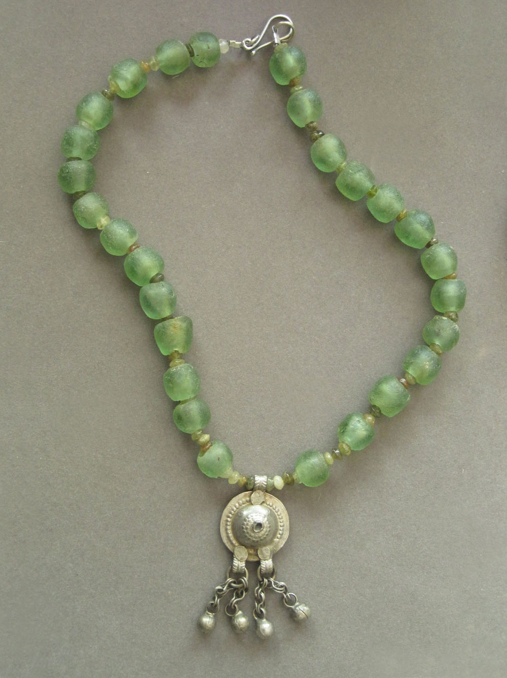 Krobo recycled glass beads (Ghana), green garnet, antique silver pendant (Afghanistan).
