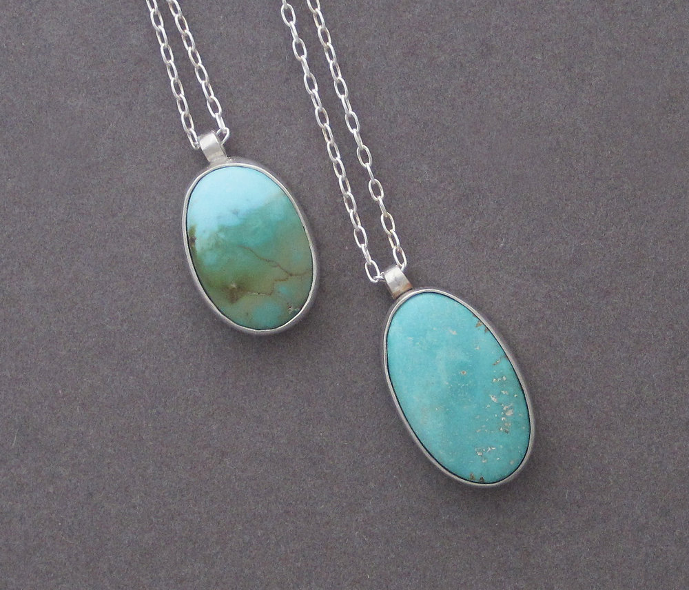 Carico Lake American turquoise pendants set in sterling silver