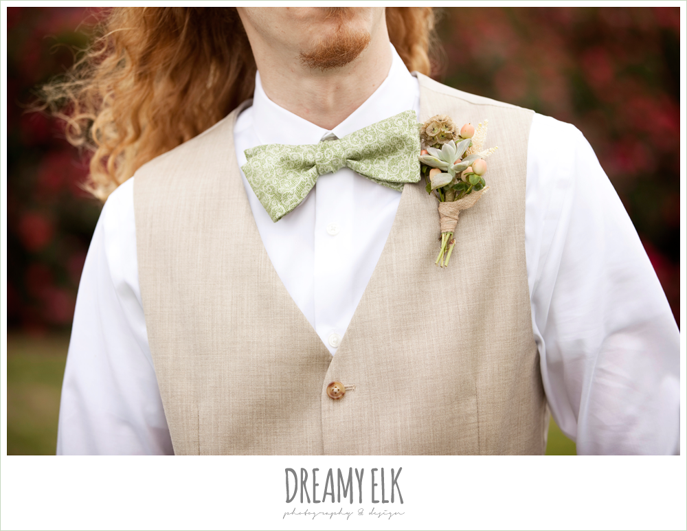 groom in linen vest with green bowtie, succulent boutonniere