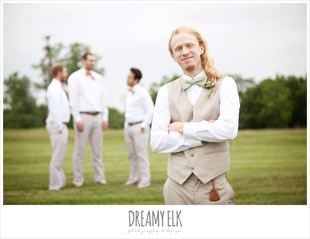 groom in linen vest and green bow tie