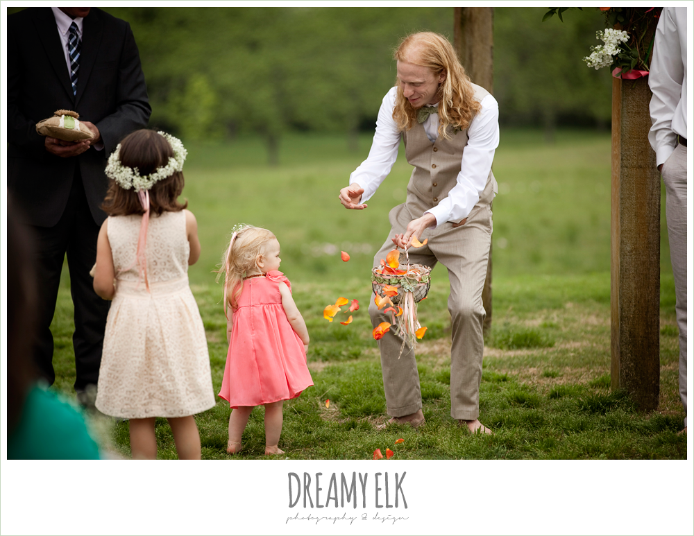 groom and flower girl throwing flowers