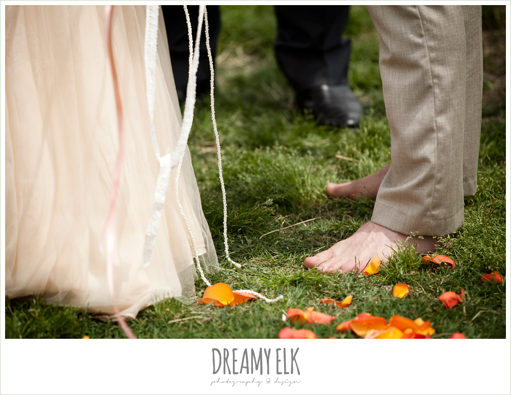 barefoot groom, orange rose petals on ground