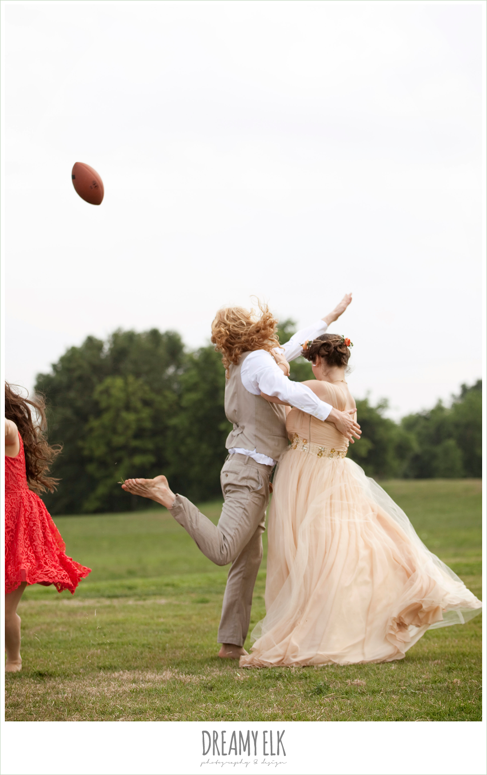 bridal party playing football, groom tackling bride
