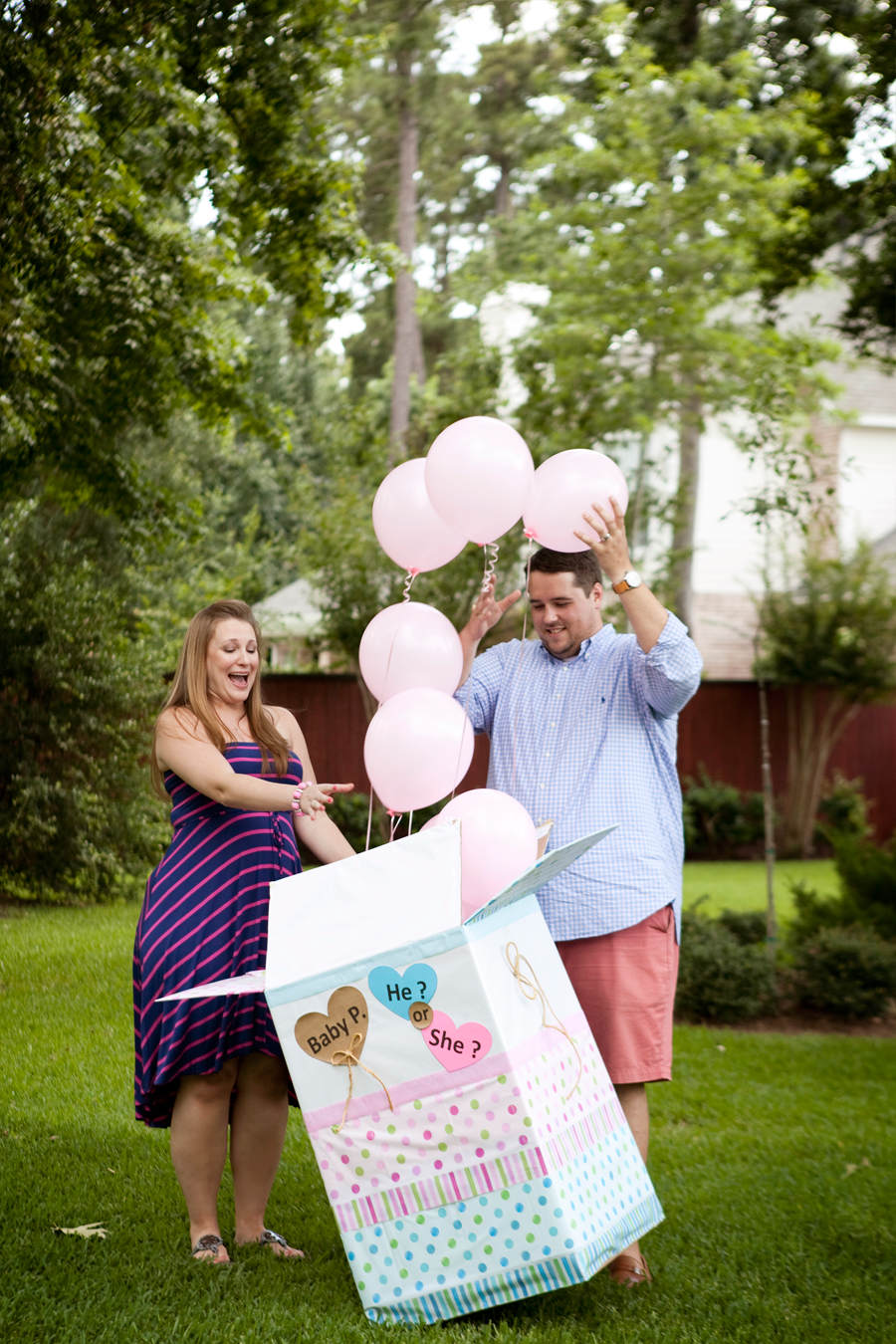 gender reveal with balloons