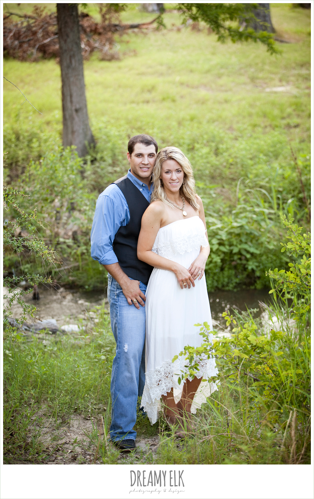 outdoor engagement photo, jeans and vest, white dress