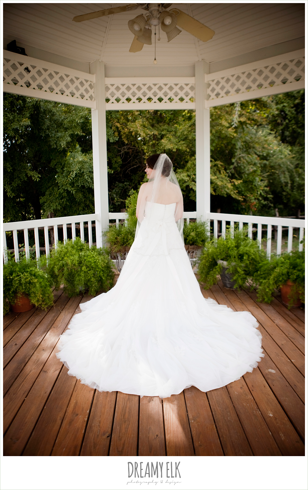 bride standing under gazebo, sweetheart strapless lace wedding dress, beaded veil,