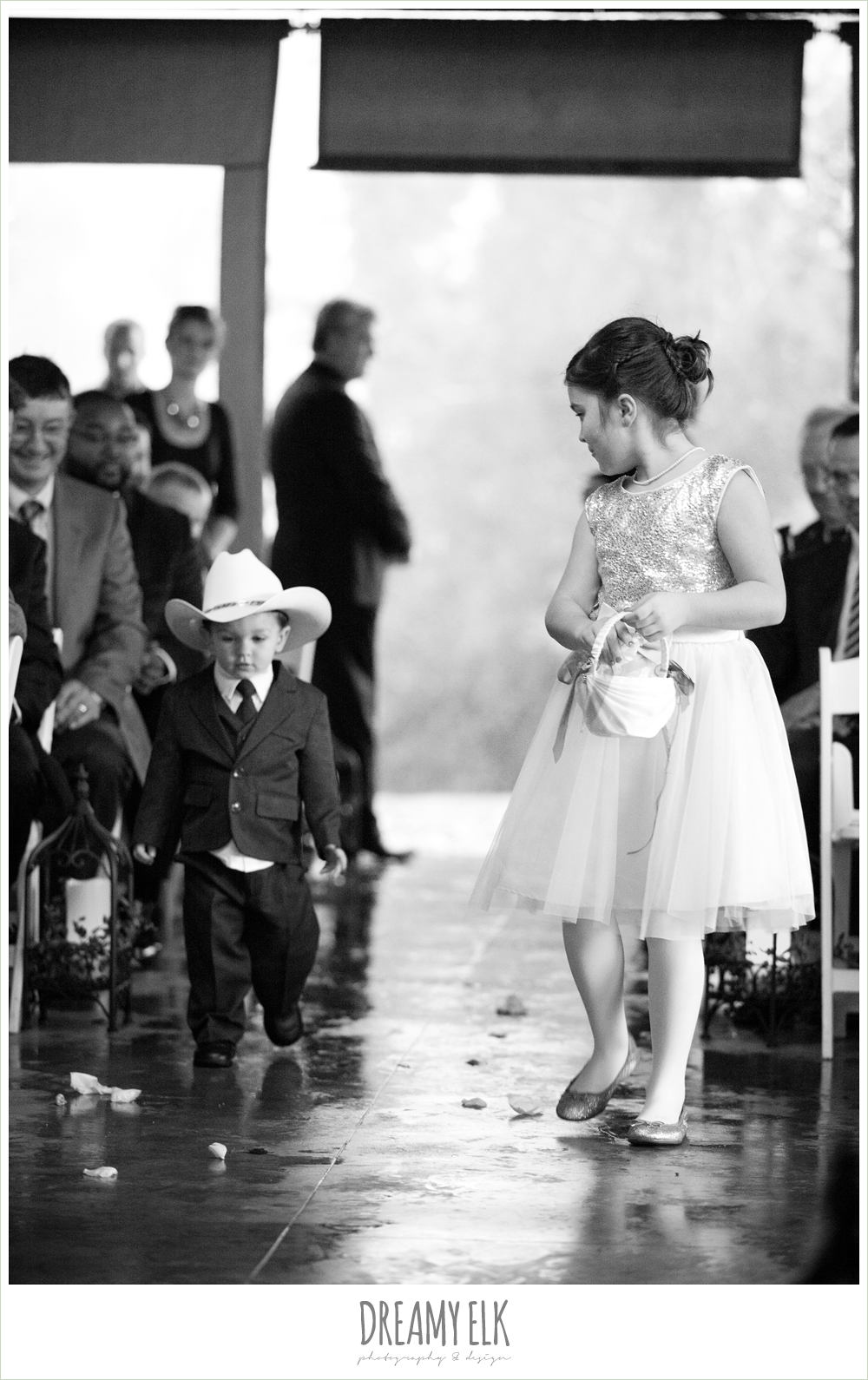 flower girl and ring bearer walking in, rainy fall wedding, rock lake ranch, dreamy elk photography and design