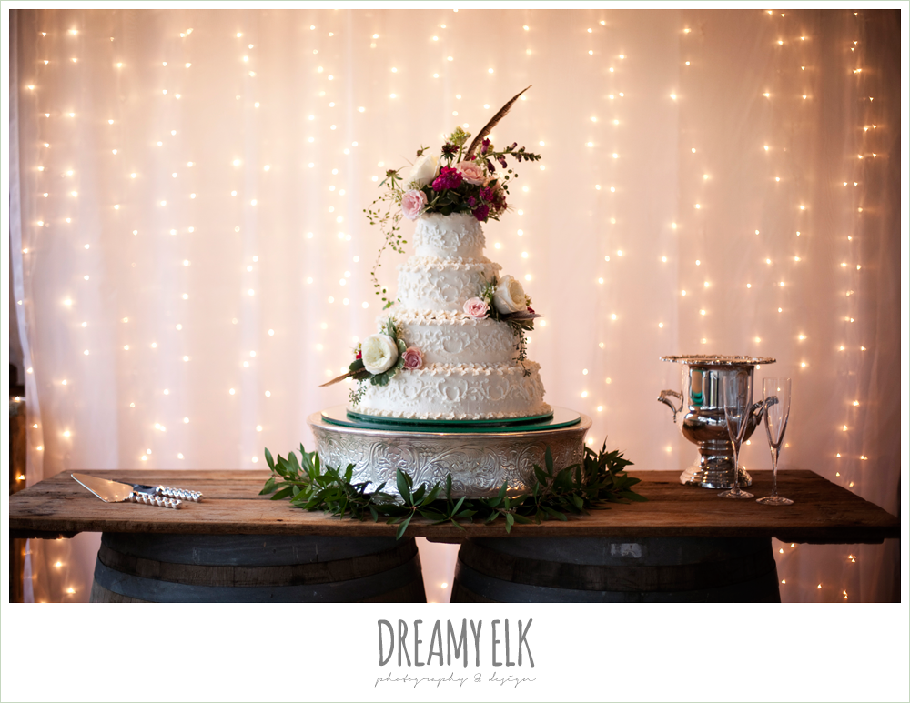 wedding cake, pheasant feathers, white ranunculus, fall wedding, rock lake ranch, dreamy elk photography and design