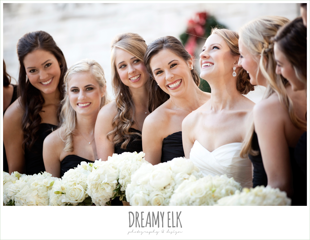 bride and bridesmaids laughing, sweetheart strapless wedding dress, white wedding bouquet, black bridesmaids dresses, winter wedding, austin wedding photographer, dreamy elk photography and design