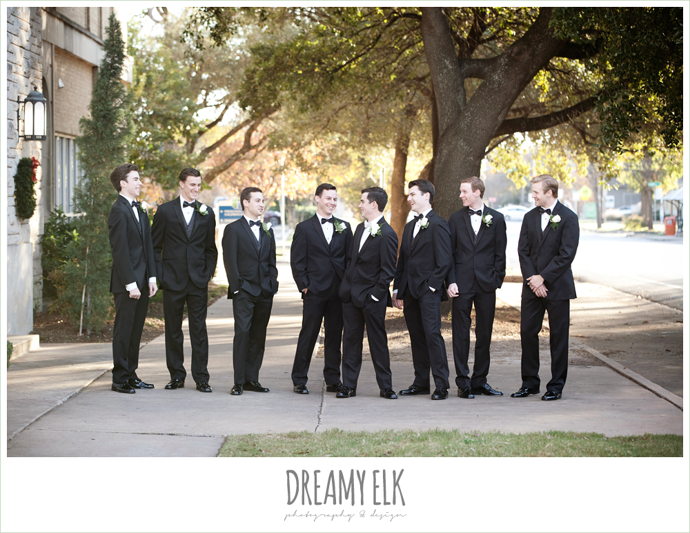 groom and groomsmen in classic tuxedos, sweetheart strapless wedding dress, white wedding bouquet, black bridesmaids dresses, winter wedding, austin wedding photographer, dreamy elk photography and design