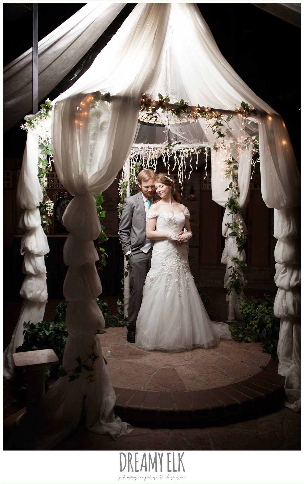 bride and groom under a gazebo, le jardin winter wedding {dreamy elk photography and design}