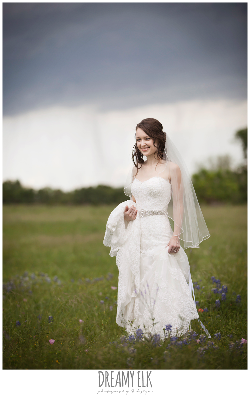 lace sweetheart strapless wedding dress, outdoor rainy day bridal photo in bluebonnets {dreamy elk photography and design}